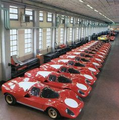 25 Ferrari 512 S race cars sit in a row at the Maranello factory for the FIA's allowance of homologation.