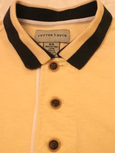 Very nice golf / polo shirt by CUTTER BUCK 100% cotton in yellow size medium. Great gift for the man on you list.