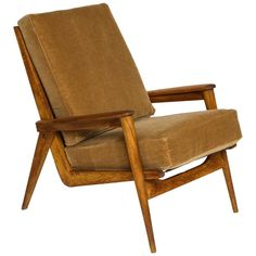 Guariche Oakwood Camel Mohair FS 105 Lounge Chair, Mid-Century France, 1950   From a unique collection of antique and modern lounge chairs at https://www.1stdibs.com/furniture/seating/lounge-chairs/