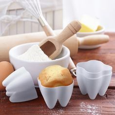 Everyone has a sweet tooth...or 3, or 4. These Sweet Tooth Baking Cups will surely help satisfy anyone's quest for a homemade sugary snack! 4 baking cups made from silicone. Each cup measures approximately 2.5 inches wide x 2.25 inches tall. Please allow 3-7 days for delivery.