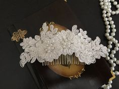The comb feautures light ivory beaded lace and pearls. Please let me know your wedding date also, so the packages arrive in time. All hair accessories are shipped within 1-3 business days. Please read mypolicies for delivery time. Thank you for visit my shop! ALL ORDERS WILL BE SHIP WİTH EXPRESS SHIPPING FOR US & CANADA & EUROPE 4-5 BUSINESS DAYS FOR US &CANADA 2-3 BUSINESS DAYS FOR EUROPE PLEASE DO NOT FOTGET TO WRITE YOUR PHONE NUMBER IN NOTE TO SELLER BOX