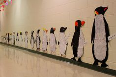 It's a penguin parade waddling down the hallway! First graders researched seventeen different kinds of penguins. In the art room, . Kinds Of Penguins, Penguins And Polar Bears, Oliver Jeffers, Groundhog Day, Classroom Displays, Classroom Themes, Winter Fun, Winter Theme, Penguin Research