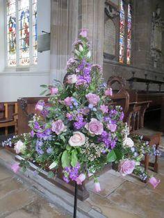 Church pedestal in fresh flowers