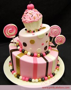 Cupcake Topsy Turvy Candy Cake by Pink Cake Box in Denville, NJ. More photos at http://blog.pinkcakebox.com/cupcake-topsy-turvy-candy-cake-2010-02-15.htm #cakes