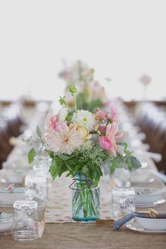 Loving mason jar centerpieces.. filled with dahlias and roses? So pretty!