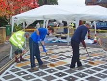 Residents painting traffic calming tile carriageway