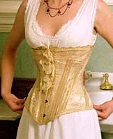 The corset was made in France. In the photographs it is being modeled by Heather. The waist measurement of the corset when fully closed is 20.5 inches. image: Matt and Lori Knowles. Ref: http://www.knowlesville.com/vintage/1900-corset.html
