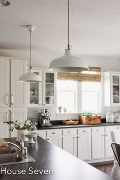 White kitchen with industrial pendant lights eclecticallyvintage.com