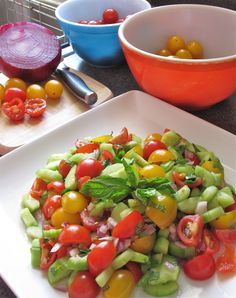 Cucumber Salad with Fresh Mint:  Cucumbers, cherry and yellow tomatoes, diced red onion, minced fresh parsley, minced fresh mint, olive oil, and lemon juice. Chop, toss, chill and serve.  Add variations with greek olives, feta cheese, garlic, or yellow bell pepper.