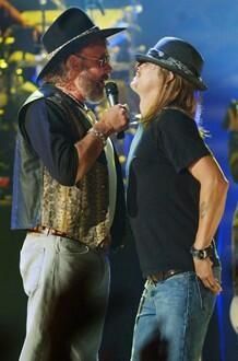 Hank Jr Kid Rock ........ they are a little rough around the edges but love our country. God bless them both.
