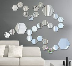 This wall decal is made from acrylic mirrors; like a mirror but much lighter. Apply removable stickers on the back, so you can arrange them