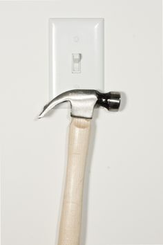NeoCover - magnetic light switch - can hold a hammer, or if you prefer practical, your keys.