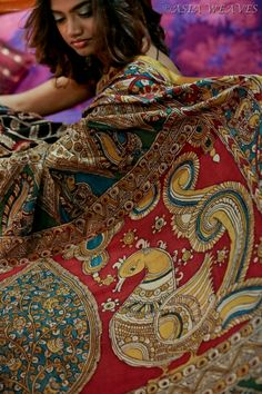 A fully hand painted kalamkari saree. From the tip of a pen of Master Artisans from Hyderabad - the allure of this piece lies in its gorgeous pallu lovely annapakshis (birds)!