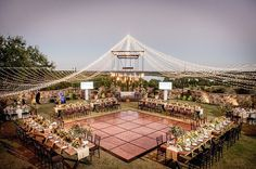 Bella Collina in Monte Verde.  Outdoor rustic wedding reception. Chandelier and twinkle lights provided by Kaleidescope event lighting