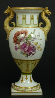 Antique ~ Berlin (KPM) porcelain ~ hand painted ~ Floral vase ~ Has a beautiful ~ Green ~ Pink ~ Ivory and Gold design over white ground ~ Has floral bouquet to front and back of body ~ Has two gilded figural Griffin beast handles ~ Circa 19th century