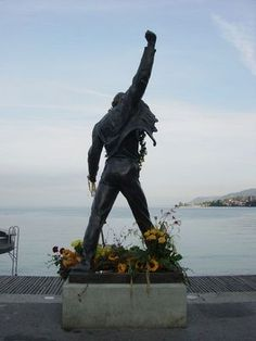 Memorial to Freddie Mercury (Queen)  Born: 1946 - Died: 1991,  Lake Geneva, Switzerland (there is no actual grave site for Freddie because he was cremated and his ashes scattered on the shore of the lake)