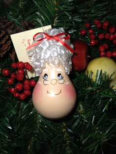 Hand painted Light bulb Mrs. Claus Christmas ornament that has been handmade from a recycled light bulb. The painting is done free handed without stencils or patterns. A wire has been added to hang your Christmas tree decoration. Mrs. Claus hair has been hand applied one strand at a time.