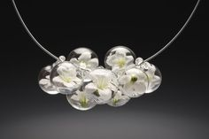 Necklace with white silk flowers in clear glass bubbles