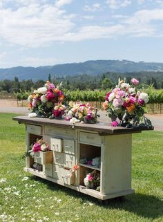 Forgo a classic altar for a vintage-looking buffet table piled with flowers.