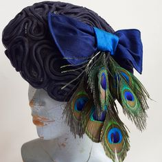 A beret style hat with silk bow and peacock feathers. Beret, Hat, Peacock Feathers, Therapy, Bows, Silk, Accessories, Arches, Hats