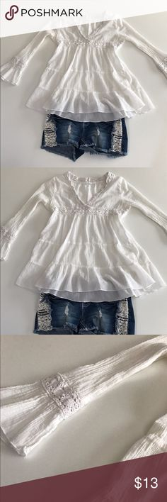 White Crotchet long sleeve beach top This long sleeve crotchet top is perfect for the beach paired with some lace/crotchet jean shorts! To wear over bikini tops as a cover up or any warm fun in the sun occasion. Size is small and condition is great! Tops Tees - Long Sleeve