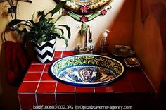 Nice combination of a Mexican sink with tile. perfect for a 1/2 bath.