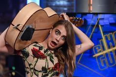 """Cara Delevingne has a passion for music and she's really, really good at it. Not only has she been writing music since she was 13, but she's killer on the drums, and also sings and plays the guitar. She recently showed off her strumming skills on the wacky Spanish TV show """"El Hormiguero"""" where she played """"Sweet Home Alabama"""" over her shoulder. Seriously!"""