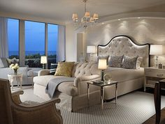 The master bedroom is all elegant design with a few contemporary touches. A bit of glamour is introduced with metallic elements.