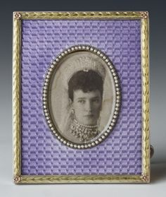 A Fabergé silver and mauve woven guilloché enamel photograph frame with raised pearl set oval bezel inset with photograph of Tsarina Marie Feodorovna (1847-1928). Workmaster Viktor Aarne, c. 1890.