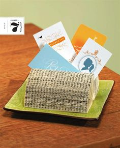 The article offers step-by-step instructions for making a business card holder by folding book pages.