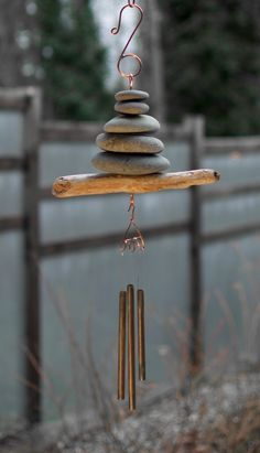 A beautiful natural Pacific driftwood and beach stones wind chime- This is the West Coast. This wind chime measures 22 inches long from the top of the copper hook to the bottom of the brass chimes. Th