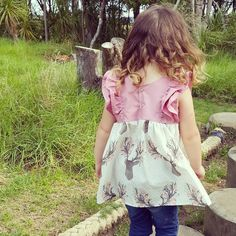 "@cottontail.nz - ""Evening trip to the playground turned into a mini photoshoot with my daughter and a Ruffle Top I made today.  So dying over her hair in this photo!!"""