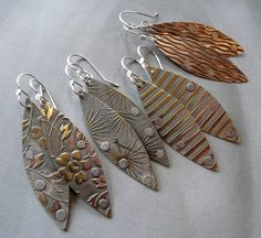 Brass, copper and aluminum riveted earrings on hand-forged sterling ear wires.