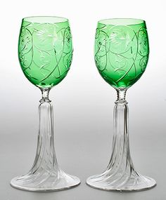 Beautiful pair of Art Nouveau wine glasses with green cased bowls decorated in intaglio with stylised sinous flowers and foliage, on clear spreading feet cut with spiral flutes. Probably Moser, Bohemia. Circa 1900. Height: 7 inches. Price: £345.00.