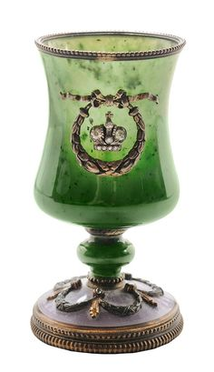 Fabergé Jade and Enamel Goblet. Moscow, late 19th/early 20th century, jade bowl with silver mounts, wreath and crown decoration, lavender enameled base with gold and silver swag decoration, rose-cut diamond accents, estimated total diamond weight 0.50 cts., marks for Faberge and Fyedor Afanasev, .916 fine.