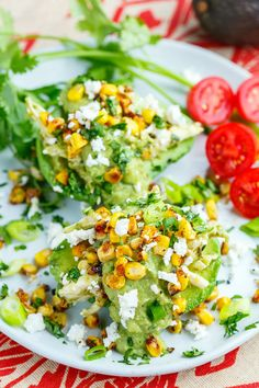 A really quick and easy take on chicken and avocado enchiladas where the chicken and avocado enchilada filling is served stuffed in cool and creamy avocados!