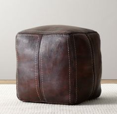 RH Baby & Child's Moroccan Leather Square Pouf:Chic and versatile, our Moroccan-inspired pouf is a welcome addition to any room, offering cushioned comfort for travelers of all sizes. Crafted of genuine leather, each piece is dyed by artisans, then carefully stitched by hand.