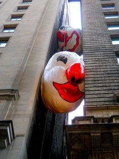 'in Endgame, giant inflatable clown heads are stuck between two buildings over an alley'..Max Streicher by rosanne maccormick-keen, via Flickr