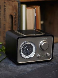 Crosley Solo Radio Speaker | Vintage-inspired American made radio featuring an AM/FM receiver featuring an aviator-style dial along with a plug, ready to fit another audio device.  With AroundSound® technology, this retro radio emits a beautiful sound quality.