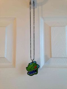 This spring, I dare to wear 90's throwbacks. #Swapdom #BefriendATrend Reptar Necklace