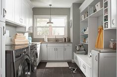 Interior : Clever Organizing Laundry Room Solutions for Your Home - U Shaped Laundry Room Design With Grey Wall, Dark Floor Tiles And Compact White Cabinets Ideas