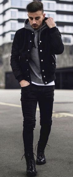 Monochrome fall combo with a black trucker jacket gray hoody white t-shirt black slim cut denim black boots. model unknown.  #fallfashion #falloutfits #menswear #menstyle #mensapparel  #hoody #mensfashion #monochrome #truckerjacket #minimal #boots