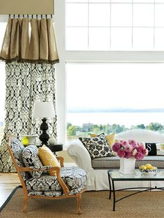 Add Texture with Burlap (or drop clothe?)              Add texture to a living room by adding a burlap valance to window treatments. The oat-color burlap also grounds a bold patterned curtain panel.                                          How to Make It:  Sew or use fabric glue to attach decorative trim to the raw edge of the burlap. Use curtain clips to hang burlap valance and curtain panels