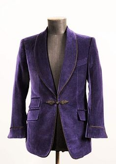 Cifonelli smoking jacket, suede shawl collar and ticket pocket. For when you host a late night gathering of a secret society and have perfected that maniacal laugh.