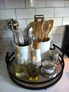 Save valuable kitchen space by organizing the kitchen counter. A few items is all you need to create a useful and decorative space. Click here to see how!