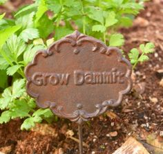 """When you just need a laugh, stick this rustic cast iron sign amongst your garden plants. Some say it brings good luck! Sign measures approx. 41/2 x 4"""" plus stake."""