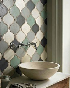 stone basin + soft hues in tiling. loving the tiles, and actually dont mind the basin! something with a bit of avocado would tie into the 50s sink we have
