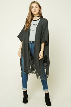 A longline slub knit cardigan featuring a drapey open front, dropped 3/4 sleeves, and a vented hem with a fringe.