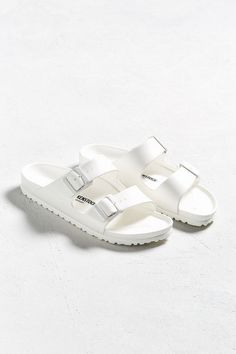 f6ceaa3c3857 Shop Birkenstock Arizona EVA White Sandals at Urban Outfitters today.