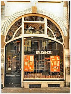 Drukwinkel in Dutch is Printshop in English.  Zutphen Holland -Beautiful art nouveau door and facade